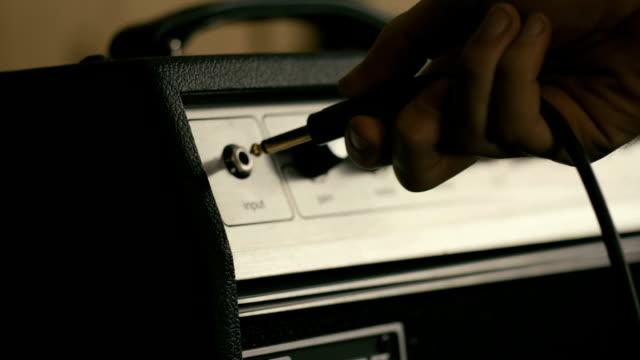 Plug in guitar amplifier in slow motion