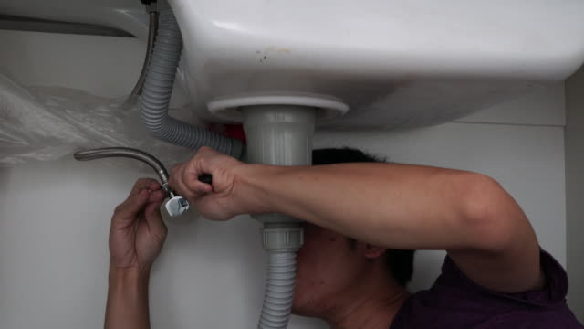 Plumber at home Plumber at home pipefitter videos stock videos & royalty-free footage