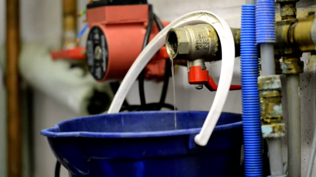 Plumber at work Plumber draining a central heating system pipefitter videos stock videos & royalty-free footage