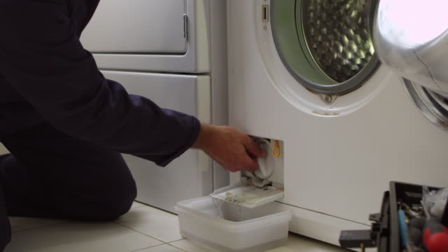 Plumber Servicing Domestic Washing Machine Shot On R3D Plumber Servicing Domestic Washing Machine Shot On R3D appliance stock videos & royalty-free footage