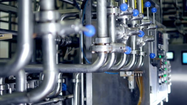 Plurality of pipelines, valves and faucets. 4K.