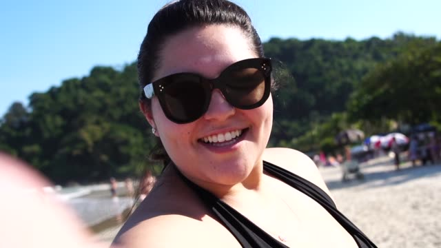 Plus Size Woman Taking a Selfie at the beach Self Portrait plus size model stock videos & royalty-free footage