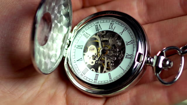 Pocket watch in male hand, minutes of human life, history. video