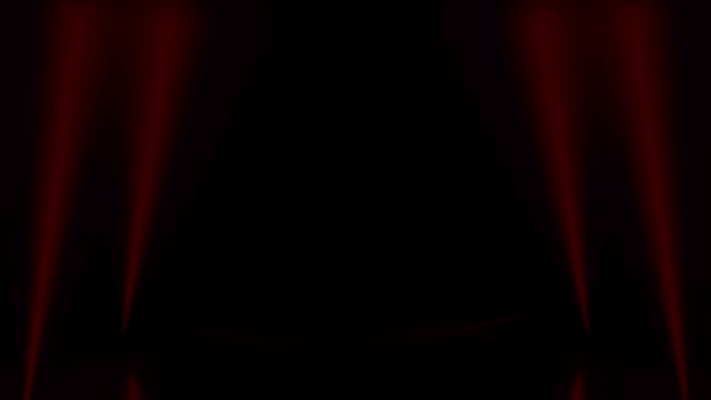 podium, road, pedestal, stage or platform illuminated by red scenic lights spotlights from the bottom and opening stage curtains. - sipario video stock e b–roll
