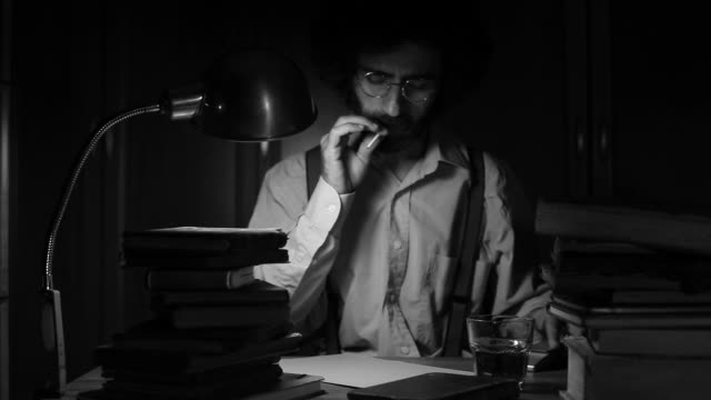 Poet writing on table in the dark video