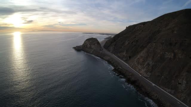 point mugu rock along pacific coast highway sunset aerial overhead view - ocean spokojny filmów i materiałów b-roll