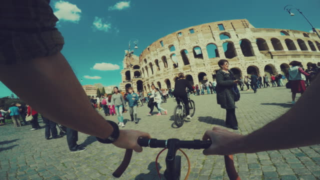Point of view POV bicycle to the Coliseum of Rome video