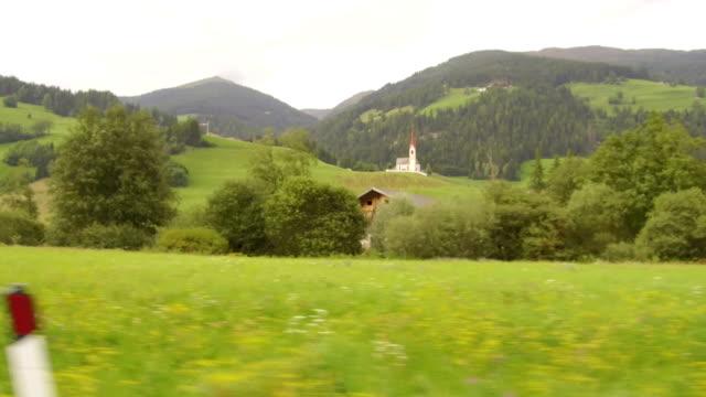 point of view by car to lienz, austria - stato federato del tirolo video stock e b–roll