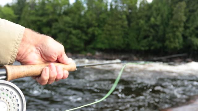 point of view fisherman fly fishing in river - łowić ryby filmów i materiałów b-roll