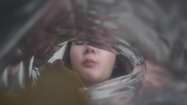 point of view from Camera Inside bag of potato chips, a woman is eating a potato. point of view from Camera Inside bag of potato chips, a woman is eating a potato. potato chip stock videos & royalty-free footage