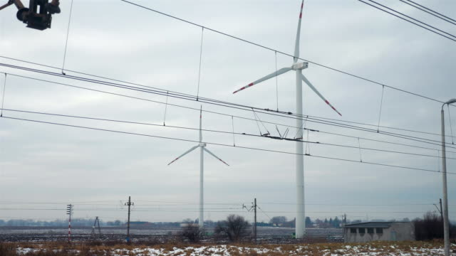 Point of view from train passing windmills in slow motion in 4k video