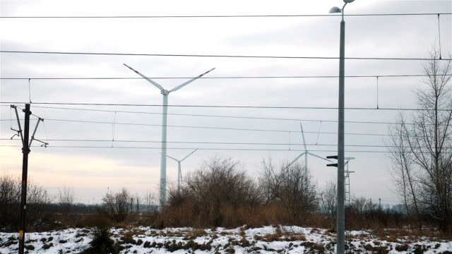 Point of view from train passing windmills in slow motion video