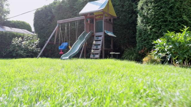 stockvideo's en b-roll-footage met pov oogpunt van een kind loopt tot speeltuin - garden
