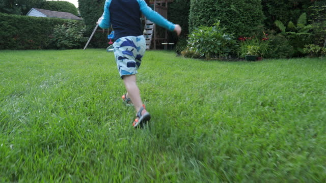 pov point of view of a kid running to playground - backyard stock videos & royalty-free footage