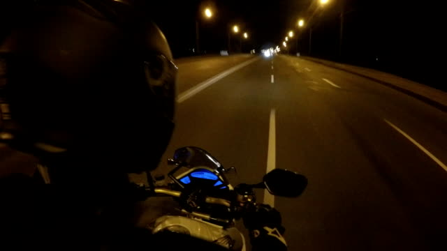 Point of view of a motorcycle rider rides in evening town road in high speed. The viewpoint of motorcyclist driving in the night empty city streets. Pov Close up Point of view of a motorcycle rider rides in evening town road in high speed. The viewpoint of motorcyclist driving in the night empty city streets. Pov Close up crash helmet stock videos & royalty-free footage