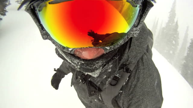 Point of view of a snowboarder in powder snow video