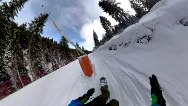 point of view of a snowboarder riding down a ski piste - fish eye video stock e b–roll