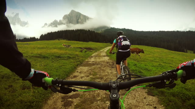 Point of view pedalling on mountainbike with girl video