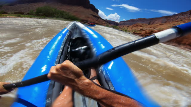 pov point of view rafting with kayak in rough colorado river, moab - utah video stock e b–roll