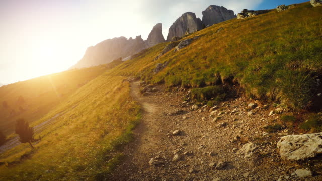 POV point of view running and hiking in mountain A man exercise trail running in a harsch mountain track, jumping over rocks, along the Friedrich August Path on the Dolomites, in Val Gardena and Val di Fassa. POV action filmed from a chest mount with an action camera. footpath stock videos & royalty-free footage