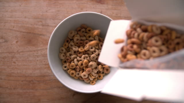 Point Of View Shot Of Pouring Breakfast Cereal Into Bowl video
