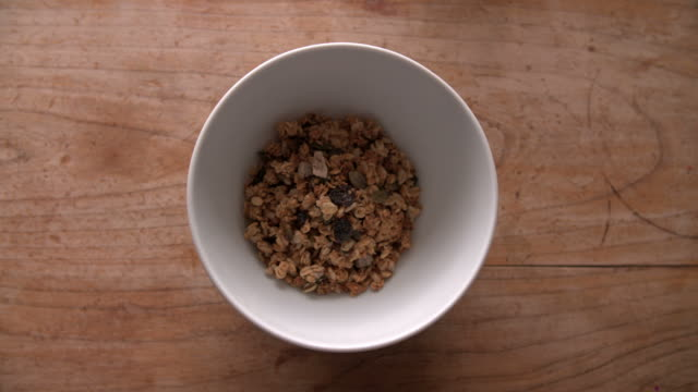 Point Of View Shot Of Pouring Muesli Into Bowl video