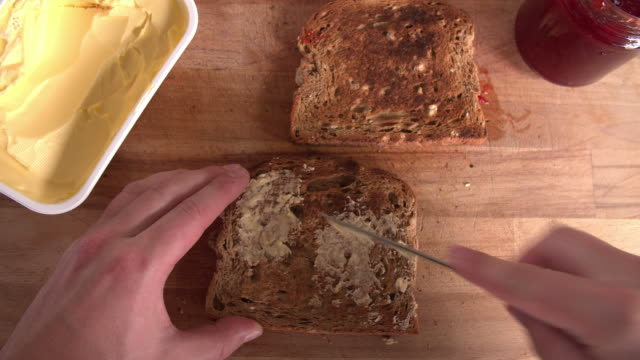 Point Of View Shot Showing Person Spreading Butter On Toast video