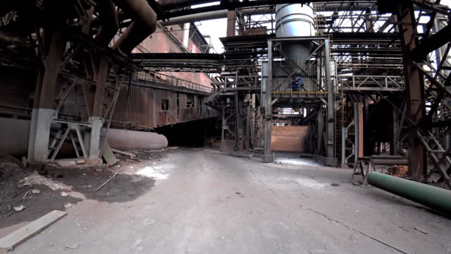 point of view walking through old dirty metallurgical plant/. 4k pov forward, action camera shoot. - imperfection stock videos & royalty-free footage