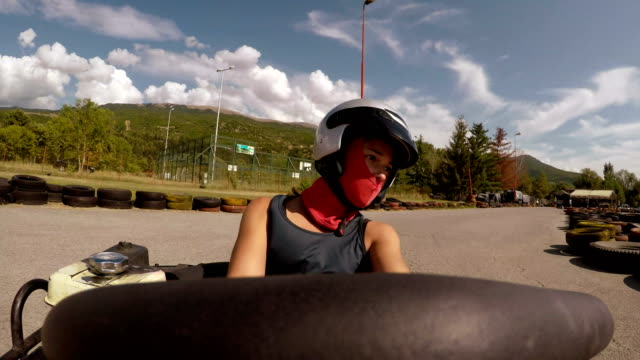 Point of view- young girl drive go-cart