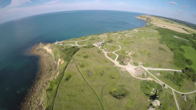 Pointe du hoc cliff, Normandy Shot over Pointe du hoc cliff, Normandy, France normandy stock videos & royalty-free footage