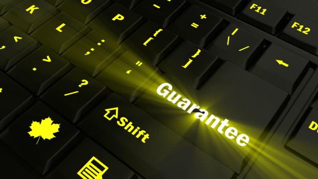 pointing on yellow glowing guarantee key - affidabilità video stock e b–roll