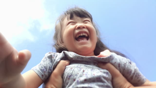 Point-of-view shot of a father spinning his young daughter around in the park, Kid Smiling at Camera video