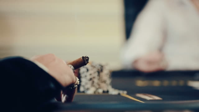 poker, a man Smoking a cigar, a player is nervous video