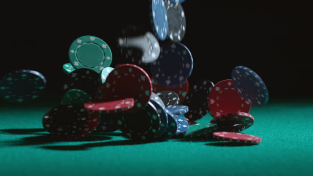 Poker chips falling in slow motion video