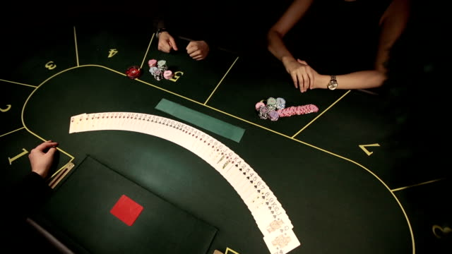 Poker dealer shuffling playing cards video