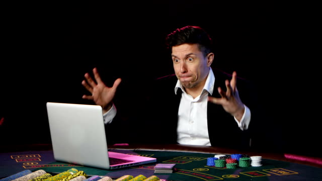Poker player gambling on online casino and lossing. Close up video