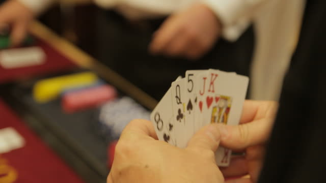 Poker player holding cards video