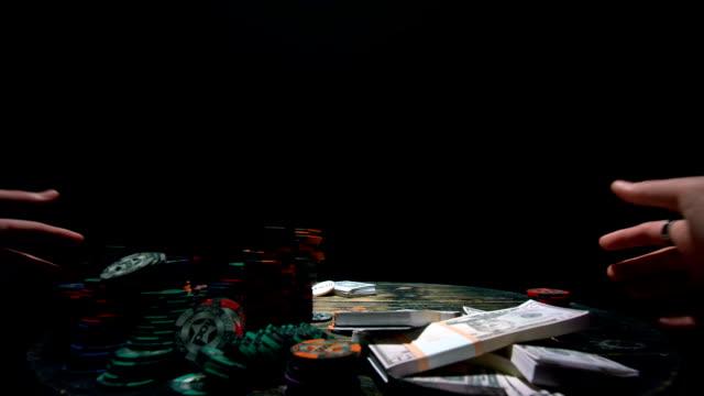 Poker player raking a big pile of chips video