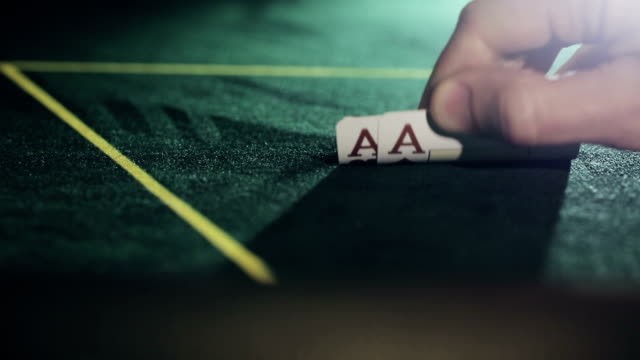 Poker player shows good pair hand for win two aces video