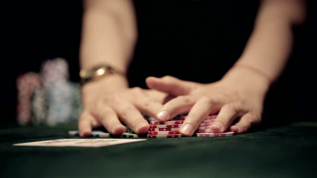 Poker players wins and takes the money. Close up video