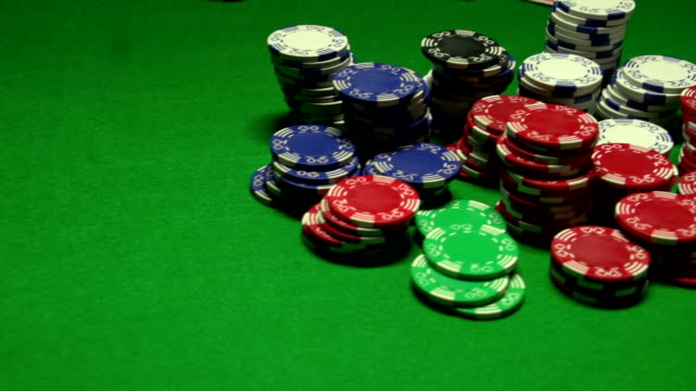 Poker players wins and takes the money video
