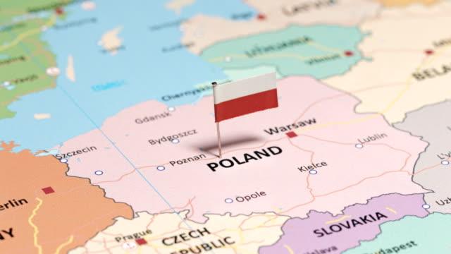 poland with national flag - polska filmów i materiałów b-roll