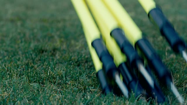 Poles for training soccer on the field, 4k slow motion