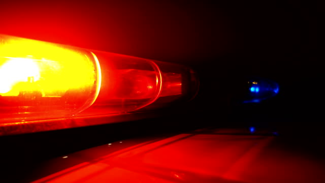 Police blue and red lamp flashing spinning in the dark