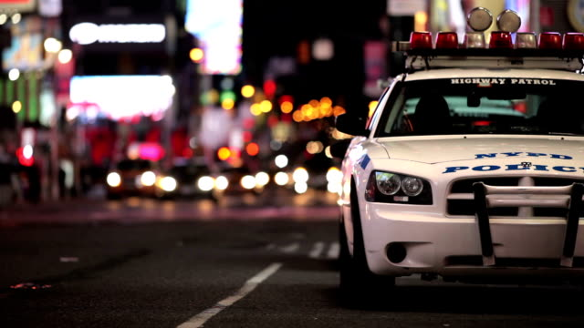 police car at night in manhattan - police officer stock videos and b-roll footage