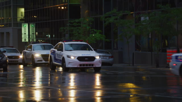 Police cars on a street in Montreal – film