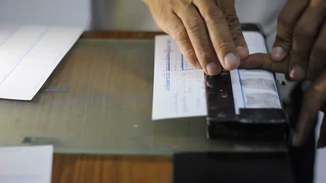Police fingerprinted accused. video