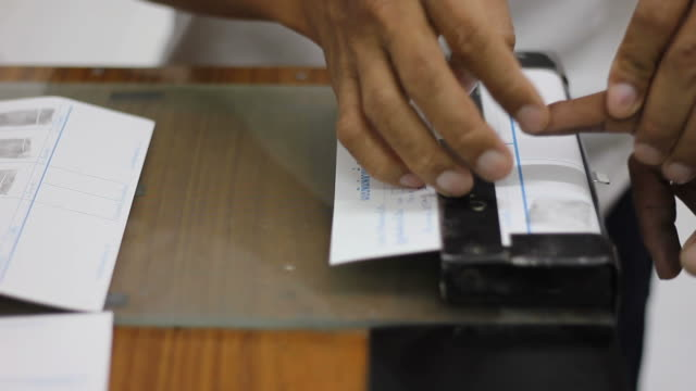 Police fingerprinted accused. video