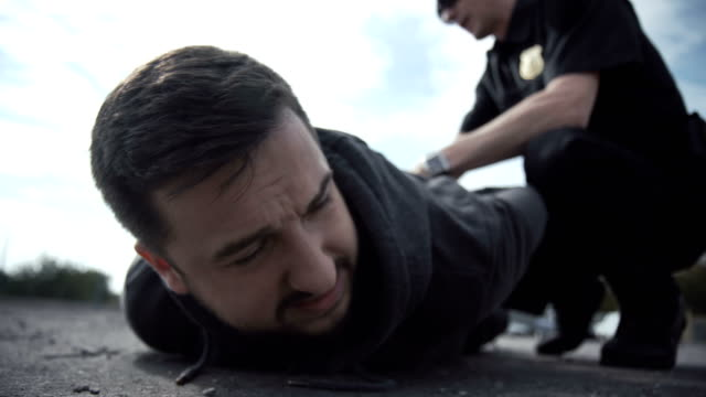 Police officer arresting a perpetrator video
