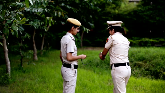 Police officer discussion about master plan with security staff HD Video : - Video of two young confidence female Indian police officer discussion about something outdoors in the nature. The Indian Police Service or IPS, is an All India Service for policing. police meeting stock videos & royalty-free footage